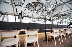 Ricardo Casas Design inverts chairs to form restaurant's lighting canopy - News - Frameweb