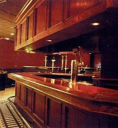 Classic wooden bar with brass foot rail