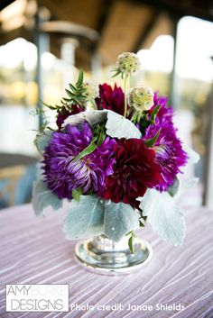 Cocktail table arrangement with Dahlias, Dusty Miller and Scabiosa Pods in a low mercury glass vase. @janaeshields  #reception Location Thomas Fogarty Winery