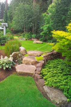 Stone steps idea and slope landscaping design.