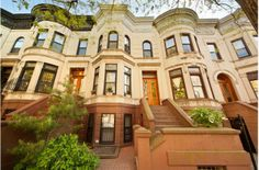 A historic limestone 2-family townhouse with a large garden and deck in Brooklyn's Park Slope. $2095000