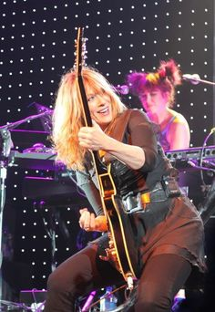 Nancy Wilson from the band Heart. Been around for a while, but still looks (and sounds) great.