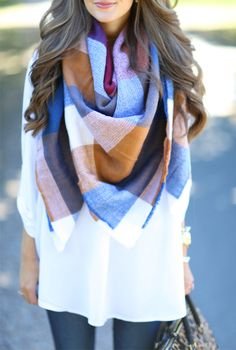 A blanket with a similar pattern to this scarf would work well.
