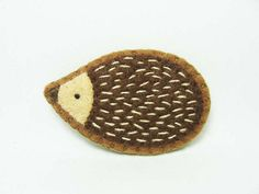 Friendly hedgehog felt brooch by hanaletters, via Flickr