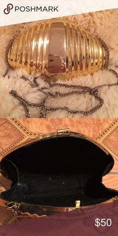 Golden clutch with long gold chain. Purse, bag Golden clutch with long gold chain. Very rich looking.  Like new condition, used once. Black velour lining. Purse, bag. Accepting Offers. Bags Clutches & Wristlets