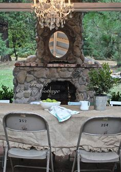 FRENCH COUNTRY COTTAGE: Just A Few Random Chairs-LOVE THE OUTDOOR FIREPLACE!