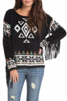 Long sleeve aztec knit sweater with pleather fringe detailing on the sleeves. Faux Leather Fringe Sweater by Elan. Fringe Sweater, Yellow Accents, Leather Fringe, Slim Legs, Sweater Outfits, Black Sweaters, Vegan Leather, Christmas Sweaters, Scoop Neck