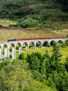 Towering over Scotland's scenic countryside, the spectacular 1,000-foot-long (305m) Glenfinnan Viaduct is famed for featuring in the Harry Potter film series. #travel #uktravel Inverness Shire, Historical Monuments, Country Estate, Dundee, Highlands, Countryside, Attraction, Travel Inspiration, Scotland