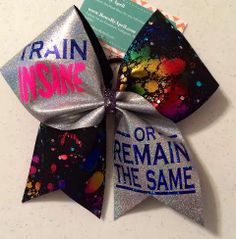 Bows by April Express - Train Insane or Remain The Same Glitter and Black Neon Splatter Cheer Bow, $19.00 (http://www.bowsbyaprilexpress.com/train-insane-or-remain-the-same-glitter-and-black-neon-splatter-cheer-bow/)