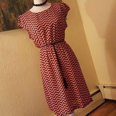 Chevron Deess Adorable chevron dress. Cap sleeves. Coral and black colors. Comes with thin braided, tassle belt. Dygarni California Dresses Asymmetrical