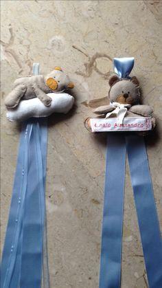 Piccoli fiocchi per annunciare la nascita di Alessandro( da portare all'asilo di Lori e Andrea)