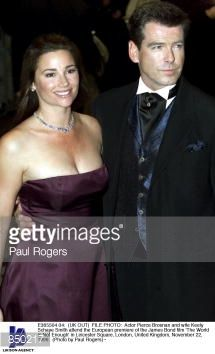 FILE PHOTO Actor Pierce Brosnan and wife Keely Schaye Smith attend the European premiere of the James Bond film ''The World Is Not Enough'' in...