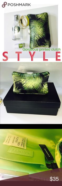 Sale ⚡️Express -  clutch Gorgeous clutch. Can be dressed up or down. Brand new. Hard case. - Silk type material on outside - pretty leaves print - green lining - open pocket inside - hard casing - silver clasp Express Bags Clutches & Wristlets