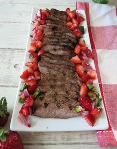 Grilled Top Sirloin with Strawberry Salsa - A tender, moist marinated sirloin steak topped with a sweet and spicy strawberry salsa.
