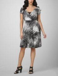 Body-conscious dress in a striking high-contrast print make this design ideal for work or play. Surplice v-neckline wraps to a bamboo-like square detail and features a solid inset for a layered look. Short sleeves. Hits just below the knee. Available in misses sizes and plus sizes. fashionbug.com