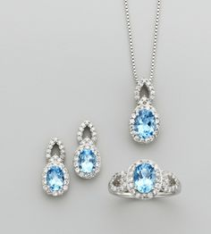 Set geniuine blue topaz & cubic zirconia in pure silver over brass