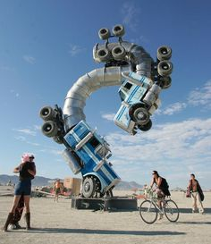 """37 Of The Most Insane Pictures Ever Taken At Burning Man - An art installation called """"Big Rig Jig"""" by artist Mike Ross is shown in 2007."""