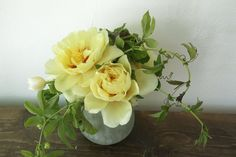 Proof that simplicity IS the essence of elegance! yellow peonies, passion vine and geranium leaves