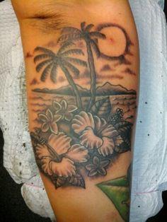 Arm tattoo tropical beach floral
