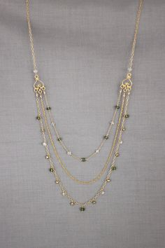 gold and green apatite triple strand necklace by perseid on Etsy, $170.00