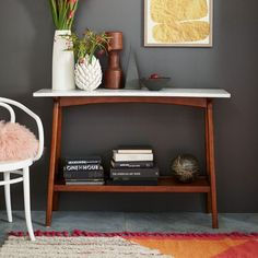 Set in stone. With its marble top and pecan-stained solid wood base, the Reeve Console's compact size makes it ideal for a hallway or behind a sofa.