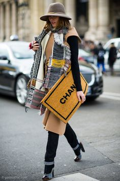 """winter outfit - incredible open weave scarf with fringe, camel coat, cuffed denim, oversized chanel """"door mat"""" zipper clutch, + chic fedora"""