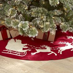 Night Before Christmas Tree Skirt | A stitched silhouette of Santa and his reindeer give a playful touch to this red tree skirt.
