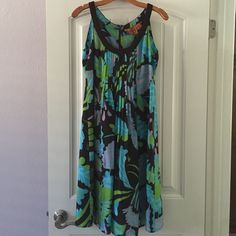 Tory Burch Floral Silk Dress This dress is stunning! 100% silk - brown background with vibrant blue, purple, and green flowers. The pleating is flattering on every figure. Back zipper. Near perfect condition - worn only a few times and always dry cleaned. Tory Burch Dresses