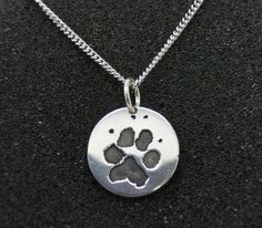 Paw-print charm necklace. Using your furry friends own individual print!! Only $975 how could you say no to this?! Make sure to order yours in time for Christmas delivery!