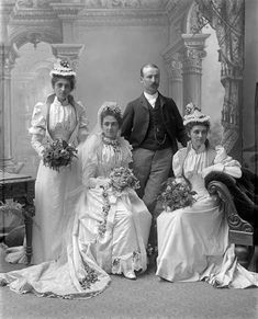 The remarkably elaborate dress that was standard Victorian wedding wear is shown in this 1890 photograph. The three women are rigidly corseted, and there was a tight inner tube within the full leg-o'-mutton sleeves. The skirts were heavy and the train made them difficult to keep clean. These restrictive clothes prompted the movement for dress reform.