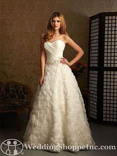 Allure Bridal Gown 2463 a ruched drop waist waistline with a belt with a feathered ball gown skirt