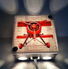 I have got to have this!Come Fly Away With Me Red Bi-Plane - Repurposed Vintage Dictionary Print Design Night Light. $38.00, via Etsy.