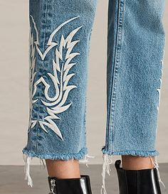 "Do denim differently this season with the indigo Philly boyfriend fit jeans. Featuring intricate embroidery inspired by traditional cowboy stitching, they're designed with a cropped leg and a frayed hem to enhance the vintage look.Low rise.Zip fly with button.5 pocket styling.Western-style embroidery.Relaxed, cropped leg.Frayed hem.Non-stretch denim. SIZE & FIT Boyfriend fit.Cropped leg length.Inseam: 66cm.Model is 5'8"" / 173cm, size 27.See our size guide for more detai..."