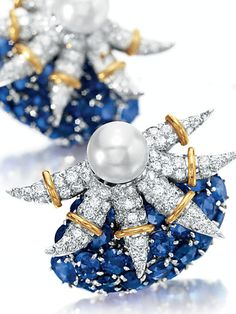 A PAIR OF DIAMOND, SAPPHIRE AND CULTURED PEARL EAR CLIPS, BY JEAN SCHLUMBERGER, TIFFANY & CO. Formerly owned by Elizabeth Taylor.