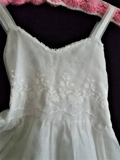 Super adorable vintage girls slip that is perfect as a summer dress. Bodice and skirt are embroidered with pretty flowers. Straps are soft nylon. Bodice is ruched on the back for comfort expandable wear. Skirt has two layers.Machine wash - very...