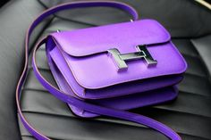 Hermes. I keep repinning it because if the color.