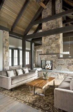 Family Room with amazing fireplace in this 'Refined Mountain Home'