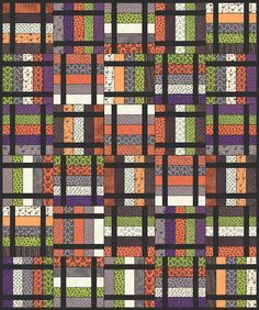 """Lets Quilt Something: Spooky Tales - Free Quilt Pattern - Jelly Roll ....Here is a easy quilt you can whip up just in time before October. Finished Size is 50"""" x 60"""". Not into Halloween? This quilt would look lovely in any fabrics!"""