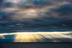 May 20, 2015. Leg 7 to Lisbon onboard Team Alvimedica. Day 03.  MAPFRE, Abu Dhabi, and Brunel appear in the early sun's rays poking through the thick clouds. Approaching the southern limits of the Greenland Ice Exclusion Zone the fleet compresses further, all six within sight of each other - Amory Ross / Team Alvimedica / Volvo Ocean Race