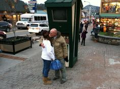 """We love traditions! This couple has been married for almost 32 years and have a tradition of taking """"kissy"""" pictures at Reagan Terrace Mall each time they visit Gatlinburg. #KissAndTellGburg"""