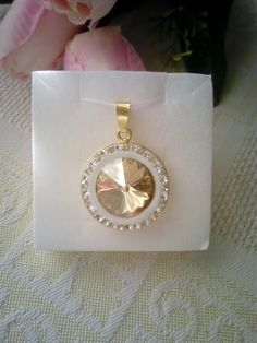 Gold plated silver pendant with Swarovski crystals in Ceralun construction.