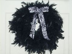 Black Feather Wreath With Balck and White Paisley Ribbon. $20.99, via Etsy.