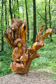 Carved wooden statue of the goddess of animals near the forest. Carved wooden statue of the goddess Tree Carving, Wood Carving Art, Garden Sculpture, Lion Sculpture, Wooden Statues, Tree Trunks, Facebook Image, Forest Animals, Life Tattoos