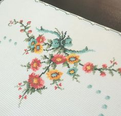 Beautiful vintage hand-embroidered table runner. 100% cotton, cross stitch needlework. Decorative floral pattern. Meticulous craftsmanship. Size: 43 x 17 Material: cotton Vintage, as-new condition, never used. Freshly washed and pressed to be ready to use right away.