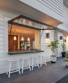 Achieving the indoor/outdoor kitchen lifestyle isn't exactly easy. But it's certainly been a trending topic during the past year. Cafe Shop Design, Cafe Interior Design, House Design, Indoor Outdoor Kitchen, Outdoor Kitchen Design, Kitchen Window Bar, Cuisines Design, Window Design, Pool Houses