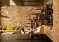 This Loft Apartment renovation centered on a built-in library was designed by architect Alex Bykov, situated in Kiev, Ukraine's historical district. Apartment Renovation, Apartment Interior Design, Interior Decorating, Design Interior, Decorating Games, Interior Designing, Decorating Websites, Appartement Design, Style Deco