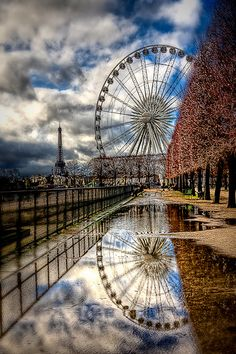 Nice water reflection of Ferris Wheel at the Tuileries in Paris, France. The Tuileries Palace was royal imperial palace which stood on the right bank of River Seine-  the usual Parisian residence of most French monarchs, from Henry IV to Napoleon III, until destroyed in upheaval of Paris Commune in 1871. The Louvre courtyard remains open at eastern end of Tuileries Garden. RESEARCH -DdO:) - http://www.pinterest.com/DianaDeeOsborne/DiDo-Reflections/ - Photo By Kay Gaensler. Pin photo via…