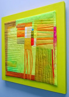 Sunny and Warm Hand dyed cottons and silks, fused, machine quilted, mounted on painted wood panel.