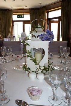 Lantern table centre with lilac flowers