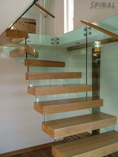 Stair, : Interesting Home Interior Decoration Using Glass Wood Freestanding Spiral Staircase Including Glass Staircase Railing And Floating Oak Wood Staircase Step